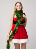 Christmas girl over tinsel Stock Images