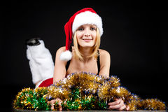 Christmas girl over tinsel Royalty Free Stock Photos