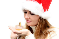 Christmas girl with  perfume Stock Photography