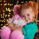 Christmas  girl with pink soft toy Stock Photo