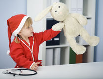 Christmas girl play at doctor and study toy Stock Photos