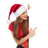 Christmas girl pointing Stock Images
