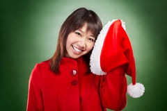 Christmas girl posing with santa hat Royalty Free Stock Photography