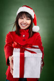 Christmas girl with present Royalty Free Stock Image