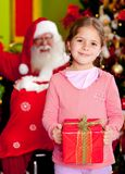 Christmas girl with a present Royalty Free Stock Photos