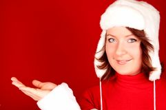 Christmas girl  presenting product Royalty Free Stock Photos