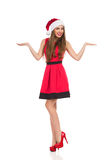 Christmas girl presenting products Royalty Free Stock Photography