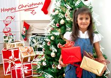 Christmas girl with presents Royalty Free Stock Photo