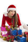 Christmas girl, presents and candle Royalty Free Stock Photos