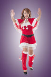 Christmas girl push something Royalty Free Stock Photography