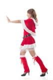 Christmas girl push something Royalty Free Stock Images