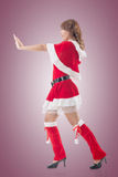 Christmas girl push something Royalty Free Stock Photos