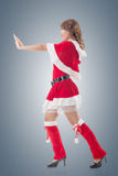 Christmas girl push something Stock Photography