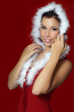 The Christmas girl on red background Royalty Free Stock Photography