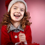 Christmas girl on red Stock Photography