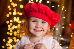 Christmas  girl in red beret Stock Images