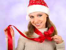 Christmas girl with red bow. Christmas girl with a red bow around his neck royalty free stock photo
