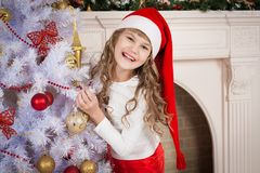 Christmas  girl  red cap and pants Stock Images