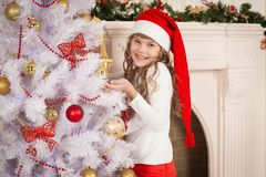 Christmas  girl  red cap and pants Royalty Free Stock Photography