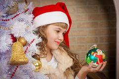 Christmas  girl  red cap and tree toy Royalty Free Stock Image
