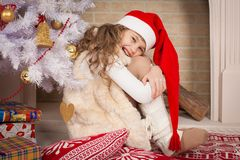 Christmas  girl  red cap and tree toy Stock Photo