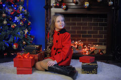 Christmas girl in a red  coat Stock Image