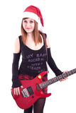 Christmas girl with a red electric guitar on white royalty free stock photography