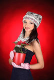 Christmas girl with red flower in her hand Stock Photos