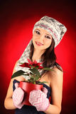 Christmas girl with red flower in her hand Stock Images