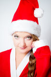 Christmas girl in the red Santa clothes Royalty Free Stock Photo