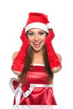 Christmas girl in red santa hat. Christmas girl wearing red santa hat over white background Royalty Free Stock Photo