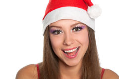 Christmas girl in red santa hat. Christmas girl wearing red santa hat over white background Royalty Free Stock Photos