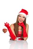Christmas girl in red santa hat. Christmas girl wearing red santa hat over white background Stock Images