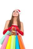 Christmas girl in red santa hat Stock Photos