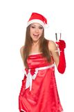 Christmas girl in red santa hat Royalty Free Stock Images