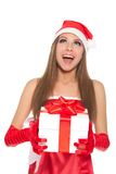 Christmas girl in red santa hat Stock Photos