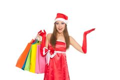 Christmas girl in red santa hat Stock Images