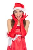 Christmas girl in red santa hat. Christmas girl wearing red santa hat over white background Stock Photography