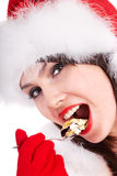 Christmas girl in red santa hat and cake on plate. Royalty Free Stock Photo