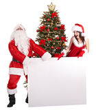 Christmas girl, santa claus with banner and tree. Stock Photography