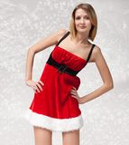 Christmas girl in santa claus clothes Stock Photo