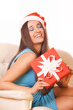 Christmas girl in santa claus hat Stock Image