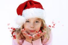 Christmas girl in Santa hat stock photos