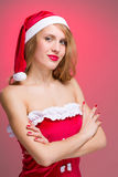 Christmas girl in santa hat Royalty Free Stock Images