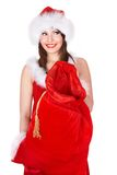 Christmas girl in  Santa hat with bag of present. Royalty Free Stock Photo