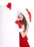 Christmas girl in santa hat with banner. Royalty Free Stock Photo