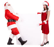 Christmas girl in santa hat with banner. Royalty Free Stock Photos