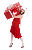 Christmas girl in santa hat with big gift box. Royalty Free Stock Images