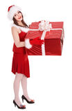 Christmas girl in santa hat with big gift box. Royalty Free Stock Photos