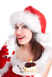 Christmas girl in santa hat and cake drink mink. Stock Photos